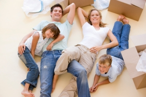 Family on floor with boxes.